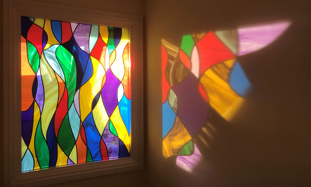 This image has an empty alt attribute; its file name is stained-glass-rainbow-window.jpg